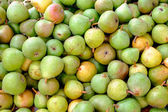 Green pears for sale — Stock Photo