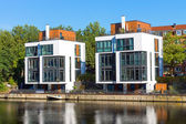 New houses at the waterside — Стоковое фото