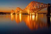 The illuminated Forth rail bridge — Stock Photo
