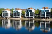 Four new houses at the waterside — Stock Photo
