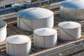 White gas storage tanks — Stock Photo