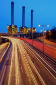 Power station behind a highway — Stock Photo
