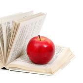 Red apple on a book  — Stock Photo