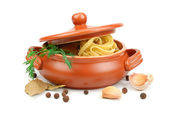 Spaghetti in a clay pot — Stock Photo