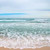 Waves sea and yellow sand       — Stock Photo