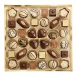 Variety of chocolates in box — Stock Photo #66418803
