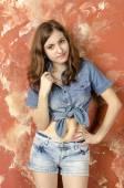 Cheerful young teen girl in denim shorts — Stock Photo