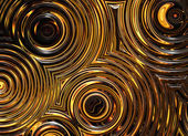 Abstract pattern of golden wet symmetrical ripple circles — Stock Photo