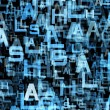 Chaotic flying of many abstract blue alphabet letters — Stock Photo #58458017