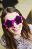 Face of cheerful smile positive young woman in stars glasses — Stock Photo