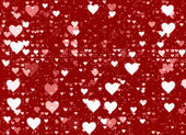 Many white small hearts on a red backgrounds — Fotografia Stock