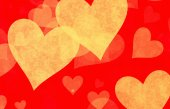 Yellow hearts on red backgrounds — Stock Photo