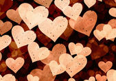 Flying light grainy hearts on brown backgrounds — Stock Photo