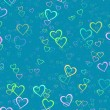 Many multicolored hearts on blue background — Stock Photo #73562827