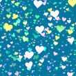Many multicolored hearts on blue background — Stock Photo #73562819