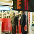 Business partners checking flight information — Stock Photo #57216267