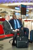 Business travellers waiting for their flight — Stock Photo