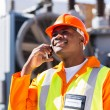 African electrician using cell phone — Stock Photo #57225889