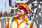 Mature electrician in electrical substation — Stock Photo
