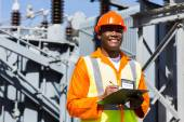 African technician working in substation — Stock Photo