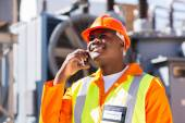 African electrician using cell phone — Stock Photo