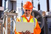 Mature electrician using laptop — Stock Photo