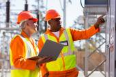Engineers working in electrical substation — Stock Photo