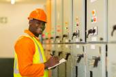 Engineer in substation control room — Stock Photo