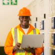 African electrical engineer with laptop — Stock Photo #57230893