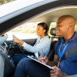 Driving instructor and student driver — Stock Photo #57403815