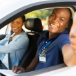 Driving instructor giving thumb up — Stock Photo #57404057