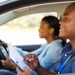 Driving instructor inside a car — Stock Photo #57404163