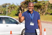 African driving school instructor — Stock Photo
