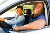 Male african-american driving instructor — Stock Photo
