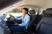 African woman driving a car — Stock Photo