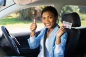 Girl holding driver's license — Stock Photo