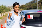 Woman showing a driving license — Stock Photo
