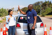 African girl and driving instructor — Stock Photo
