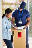 Customer signing for delivery — Stock Photo