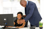 African boss guiding his employee — Stock Photo