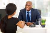 Businessman handshaking with client — Stock Photo