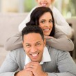 Family pyramid on couch — Stock Photo #57493239