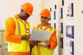 Technicians using laptop — Stock Photo