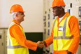 Electrical engineers handshaking — Stock Photo