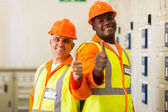 Engineers giving thumbs up — Stock Photo