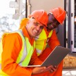 Engineer with co-worker in substation — Stock Photo #58175373