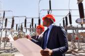 Managers working in electric substation — Foto Stock