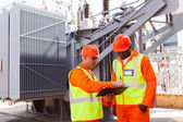 Electrical engineers discussing work — Stock Photo