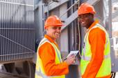 Electricians in electrical substation — Stock Photo
