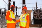 Technicians meeting in electrical substation — Stock Photo